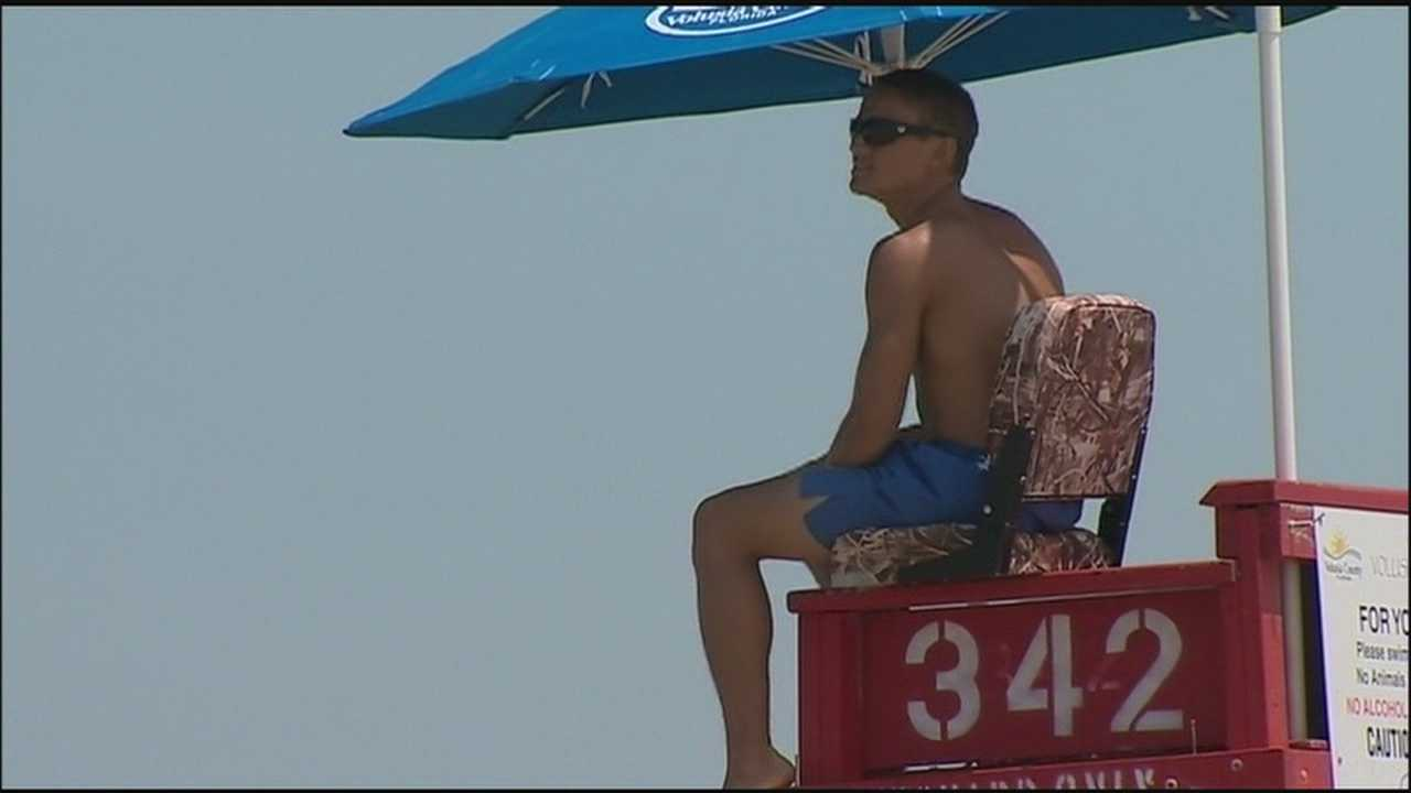 Lifeguards are warning beachgoers to swim near their towers and to be careful as dangerous rip currents continue to keep the rescuers busy.