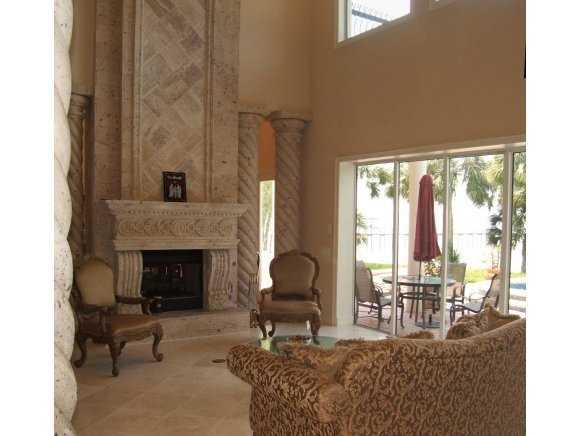 The living room has a two-sided, Cantera stone fireplace.