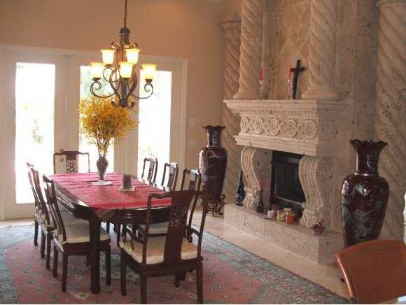 This photo of the dining room shows the other side of the Cantera stone fireplace.