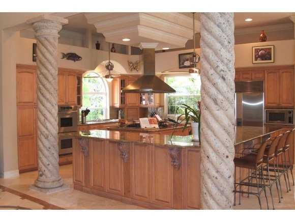 Open layout in the kitchen allows plenty of space to cook for and entertain large parties.
