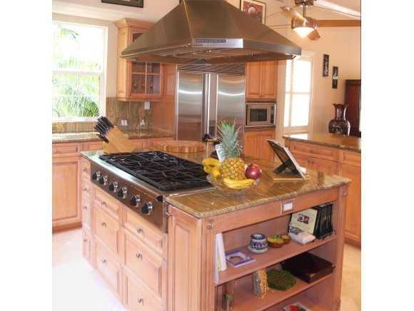Huge kitchen island and state-of-the-art appliances in this summer kitchen.