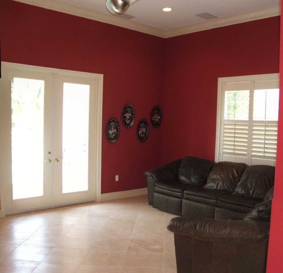 Family room features an entrance to the pool area as well.