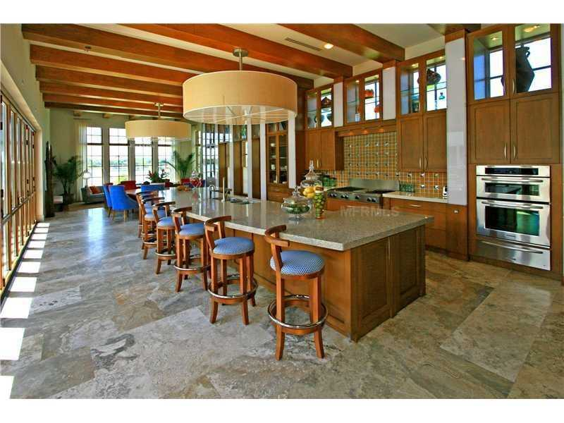 The kitchen's sprawling windows bring the outdoors and beautiful lake view indoors.