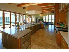 The kitchen features modern cabinetry.