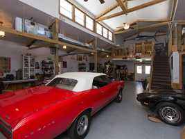 This garage is perfect for any hobby. It even has a upstairs loft.