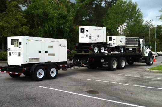 Generators arrive to power several national and local media outlets covering the trial.