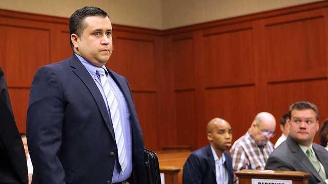Zimmerman walking in court February.jpg