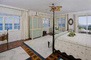 This very spacious master bedroom has panoramic ocean views.