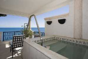No need to leave your unit for a dip in a hot tub. Your balcony has its own overlooking the sea.