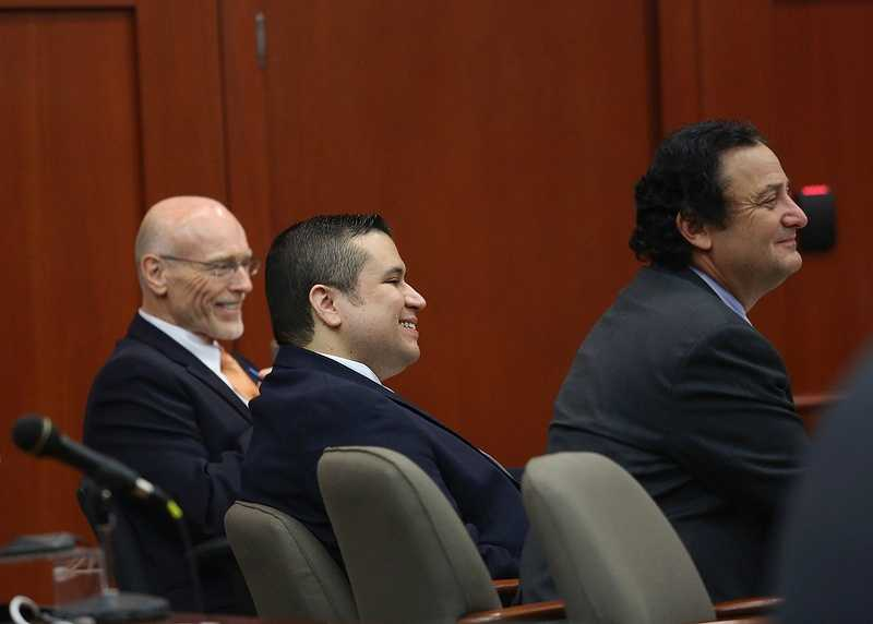 George Zimmerman, center, smiles along with co-counsel Don West, left, and jury consultant Robert Hirschhorn, right, during jury selection in Seminole circuit court on the 4th day of George Zimmerman's trial, in Sanford, Fla., Thursday, June 13, 2013. Zimmerman is accused in the fatal shooting of Trayvon Martin. (Jacob Langston/Orlando Sentinel/POOL)