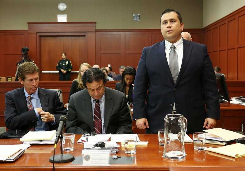 George Zimmerman answers the judge as his attorney Mark O'Mara , left, and jury consultant Robert Hirschhorn look on in Seminole circuit court on the 4th day of George Zimmerman's trial, in Sanford, Fla., Thursday, June 13, 2013. Zimmerman is accused in the fatal shooting of Trayvon Martin. (Jacob Langston/Orlando Sentinel/POOL) in Seminole circuit court on the 4th day of George Zimmerman's trial, in Sanford, Fla., Thursday, June 13, 2013. Zimmerman is accused in the fatal shooting of Trayvon Martin. (Jacob Langston/Orlando Sentinel/POOL)