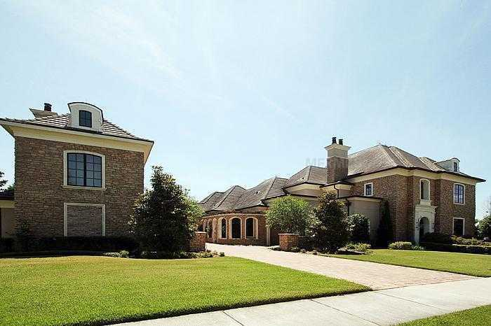 The 9,303 square ft. home sits on .73 acres of land.