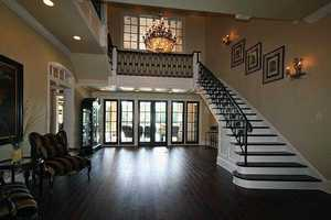 Mahogany wide plank hardwood floors are featured throughout the home.