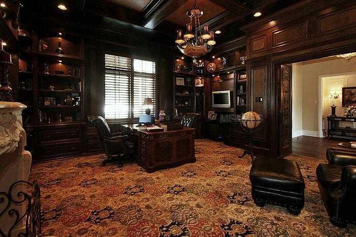 Custom private office with stunning woodwork, lush carpets,& fireplace!