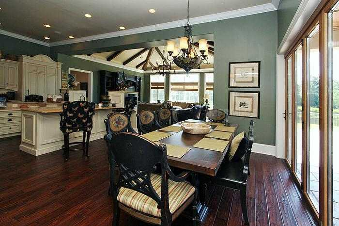 """This rustic dining table takes on the rustic-chic design throughout this """"French manor"""" inspired home."""