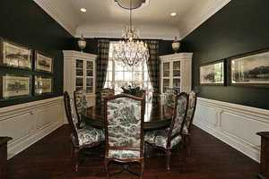 Formal dining room elevates the rustic style and elegant charm with the perfect blend of both.