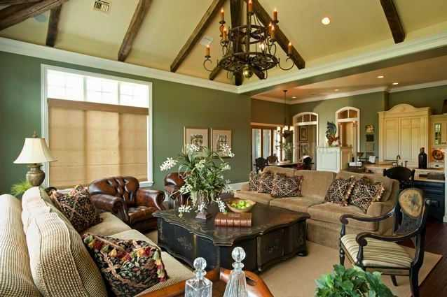 Across from the kitchen, you'll find this amazing family room. Rather than the focus being a TV, the focus is your company, as all the seating faces the center.