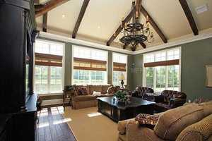 Alternate view of the family room, exposing the wide windows on each wall bringing in plenty of natural light.