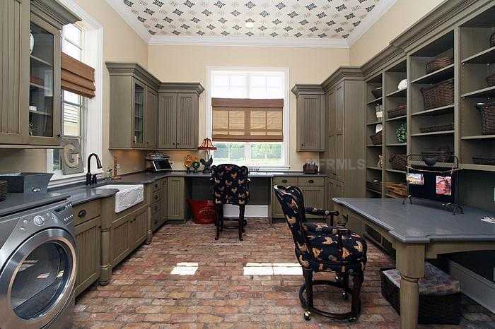 Laundry room is spacious enough to avoid clutter.