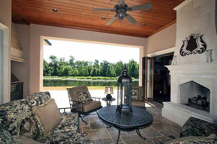 Outdoor cabana overlooking the lake is perfect for entertaining your guests in the shade.