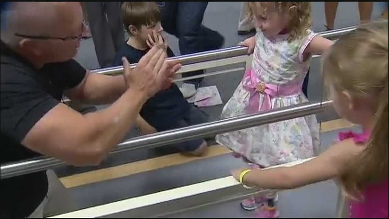 After a tragic accident, a local child is fitted with new prosthetic legs so she can walk again.