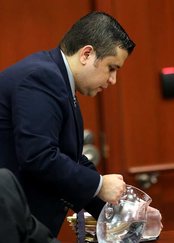 George Zimmerman pours a glass of water, in Seminole circuit court on the 7th day of his trial, in Sanford, Fla., Tuesday, June 18, 2013. Zimmerman is accused in the fatal shooting of Trayvon Martin. (Joe Burbank/Orlando Sentinel)