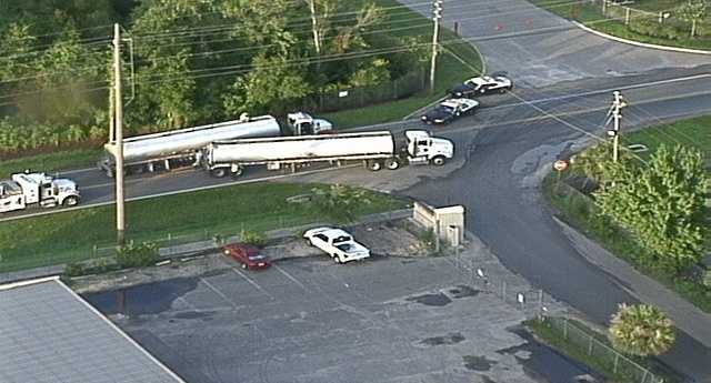 A crash involving a semi-truck and an SUV has shut down an Orange County road.