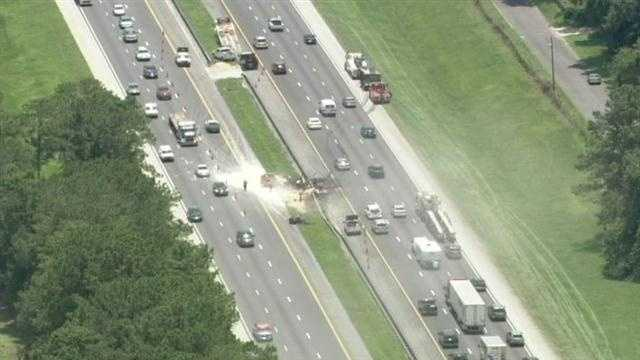 A dump truck crashed and burst into flames on Interstate 75 in Ocala on Thursday morning.