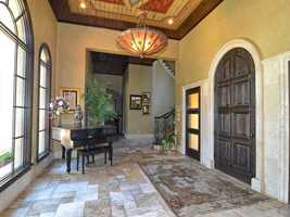 The unique foyer gives you taste of what awaits you in this award-winning home.