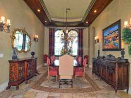 Dining room is masterfully tiled and also features artfully designed ceilings with wooden moldings.