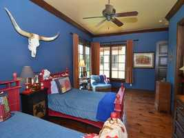 Your younger house mates will love this decked out western bedroom. The home has a total of 6 bedrooms.