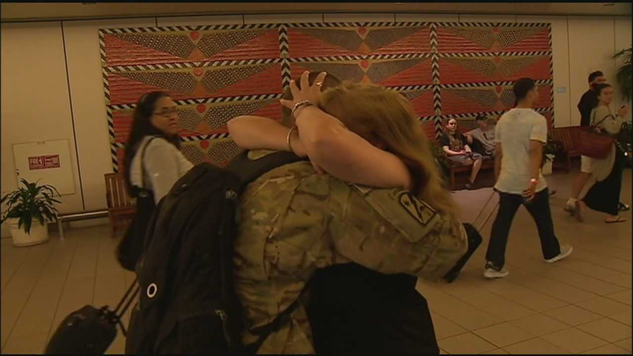 A woman who dedicates her time helping other soldiers and their families was reunited with her son after an emotional year.