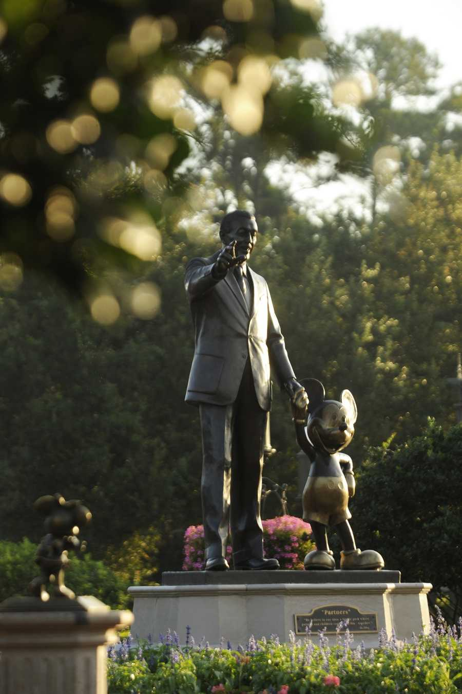 The statue of Walt Disney holding hands with Mickey Mouse known as the Partners Statue was unveiled at the Magic Kingdom in June 1995, and is the second Partners Statue after the first was installed at Disneyland in 1993.  Here are five facts about the famous statue.