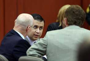 George Zimmerman talks to his defense team during his trial in Seminole circuit court in Sanford, Fla. Thursday, June 27, 2013. Zimmerman has been charged with second-degree murder for the 2012 shooting death of Trayvon Martin. (Jacob Langston/Orlando Sentinel)
