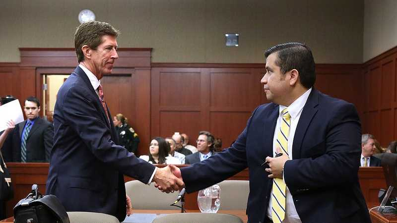 George Zimmerman is greeted by his attorney, Mark O'Mara, before the start of the 15th day of his trial in Seminole circuit court, in Sanford, Fla., Friday, June 28, 2013. Zimmerman is accused in the fatal shooting of Trayvon Martin. (Joe Burbank/Orlando Sentinel/POOL)