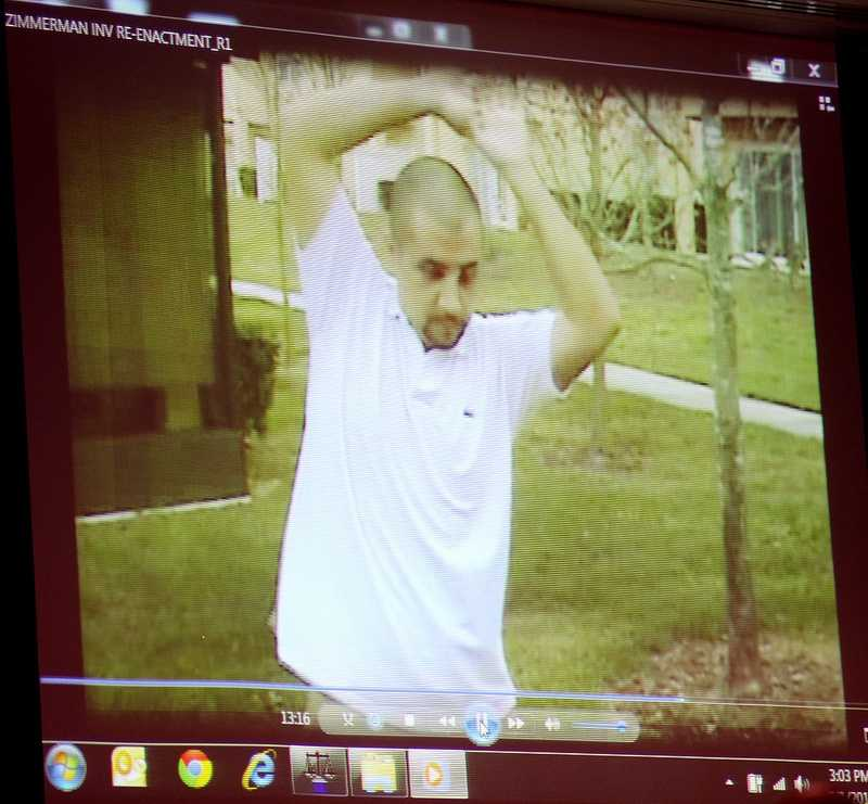 A reenactment video showing George Zimmerman with Sanford police investigators, taken the after the Trayvon Martin shooting, is projected for the jury during the 16th day of his trial in Seminole circuit court, in Sanford, Fla., Monday, July 1, 2013. Zimmerman is accused in the fatal shooting of Trayvon Martin. (Joe Burbank/Orlando Sentinel/POOL)