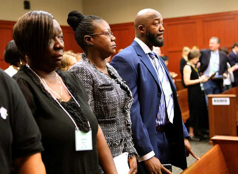 The parents of Trayvon Martin, Sybrina Fulton and Tracy Martin, with Trayvon Martin's Aunt, Stephanie Fulton Sands (left), stand for the jury's arrival in the coutroom at the start of the George Zimmerman trial on the 17th day, in Seminole circuit court, in Sanford, Fla., Tuesday, July 2, 2013. Zimmerman is charged with 2nd-degree murder in the fatal shooting of Trayvon Martin, an unarmed teen, in 2012. (Joe Burbank/Orlando Sentinel/POOL)