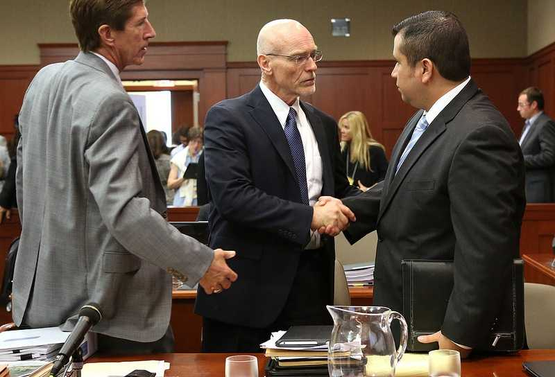 George Zimmerman shakes hands with defense attorney Don West, with Mark O'Mara (left), at the end of the 16th day of his trial in Seminole circuit court, in Sanford, Fla., Monday, July 1, 2013. Zimmerman is accused in the fatal shooting of Trayvon Martin. (Joe Burbank/Orlando Sentinel/POOL)