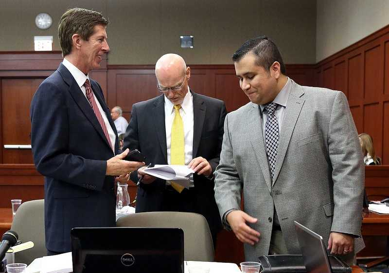 George Zimmerman, with his attorneys, Mark O'Mara (left), and Don West, during a recess on the 17th day of Zimmerman's trial in Seminole circuit court, in Sanford, Fla., Tuesday, July 2, 2013. Zimmerman is charged with 2nd-degree murder in the fatal shooting of Trayvon Martin, an unarmed teen, in 2012. (Joe Burbank/Orlando Sentinel/POOL)