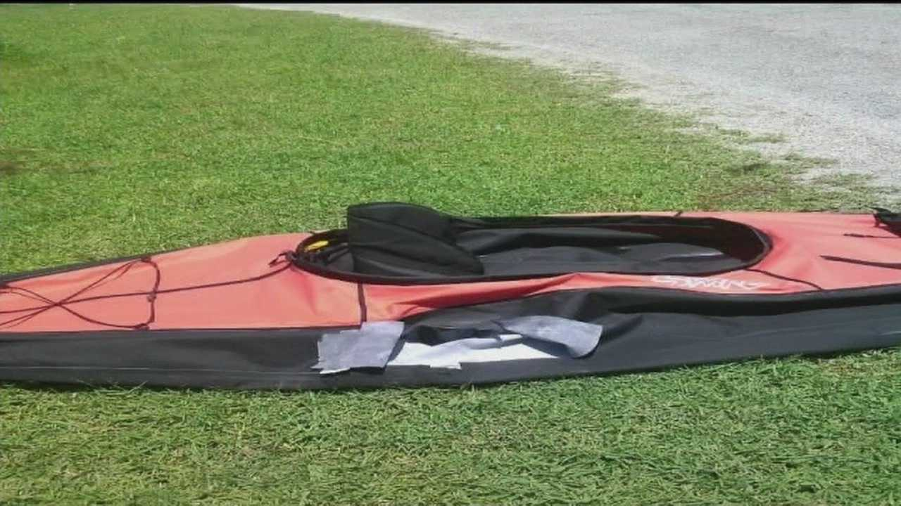 A woman calls 911 after her inflatable kayak was attacked by an alligator.