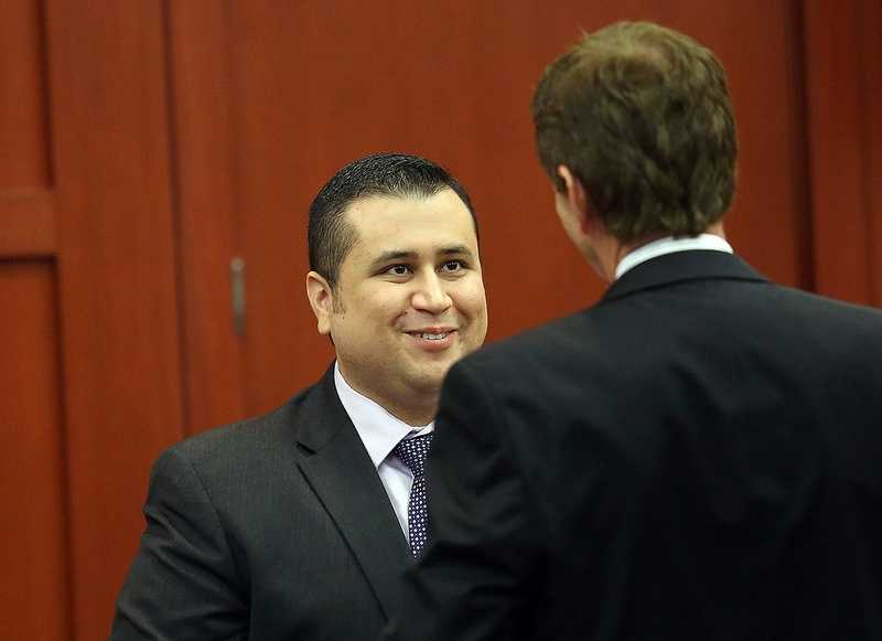 George Zimmerman, left, and Defense attorney Mark O'Mara chat during an early morning recess in Zimmerman's trial in Seminole circuit court, in Sanford, Fla., Wednesday, July 3, 2013. Zimmerman is charged with 2nd-degree murder in the fatal shooting of Trayvon Martin, an unarmed teen, in 2012. (Jacob LangstonOrlando Sentinel/POOL)