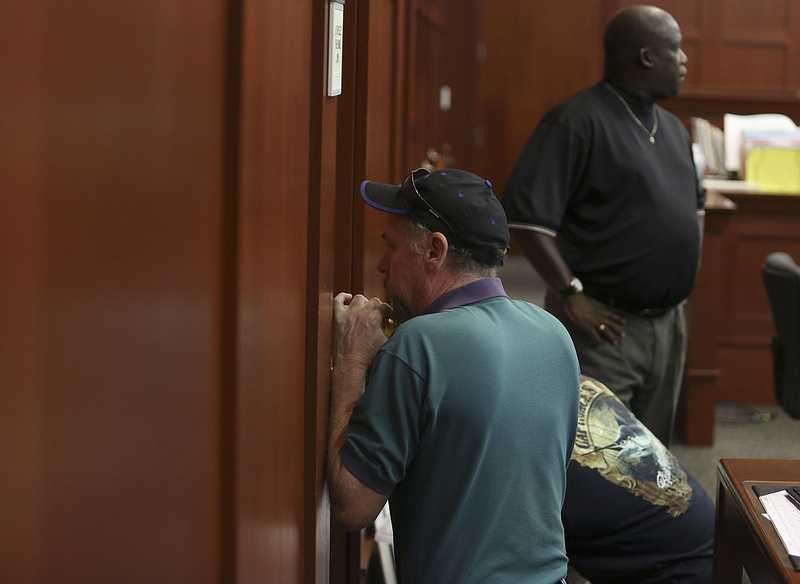 A locksmith drills into the evidence room door during George Zimmerman's trial in Seminole circuit court in Sanford, Fla. Friday, July 5, 2013. The battery on the doorlock had died, preventing the court from retrieving evidence needed for the days proceedings. Zimmerman has been charged with second-degree murder for the 2012 shooting death of Trayvon Martin. (Gary W. Green/Orlando Sentinel)