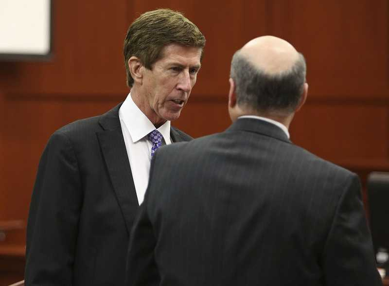 Defense attorney Mark O'Mara, left, talks with assistant state attorney Bernie de la Rionda during George Zimmerman's trial in Seminole circuit court in Sanford, Fla. Friday, July 5, 2013. Zimmerman has been charged with second-degree murder for the 2012 shooting death of Trayvon Martin. (Gary W. Green/Orlando Sentinel)