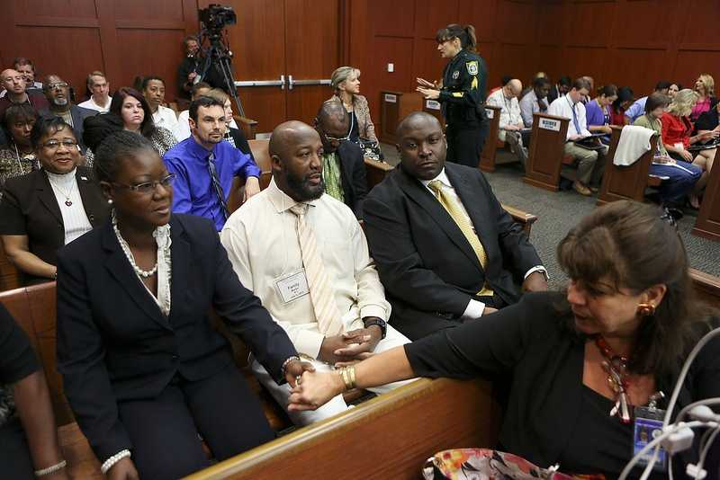State Attorney Angela Corey, right, reaches to comfort Sybrina Fulton, Trayvon Martin's mother, before she she took the stand during George Zimmerman's trial in Seminole circuit court in Sanford, Fla. Friday, July 5, 2013. Trayvon's father, Tracy Martin and family attorney Daryl Parks, far left, sit beside her. Zimmerman has been charged with second-degree murder for the 2012 shooting death of Trayvon Martin. (Gary W. Green/Orlando Sentinel)