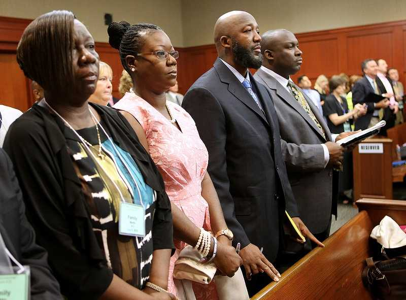 The parents of Trayvon Martin, Tracy Martin and Sybrina Fulton (center), stand for the jury on the 20th day of the George Zimmerman trial in Seminole circuit court, in Sanford, Fla., Monday, July 8, 2013. Zimmerman is charged with 2nd-degree murder in the fatal shooting of Trayvon Martin, an unarmed teen, in 2012. At far left, Trayvon Martin's aunt, Stephanie Fulton Sands. At far right, family attorney Daryl Parks. (Joe Burbank/Orlando Sentinel/POOL)