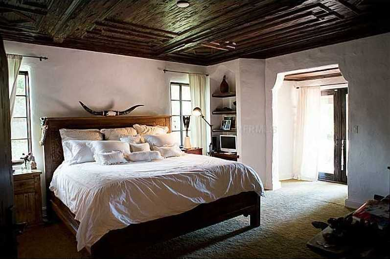 Cypress wood covers the ceiling of this master bedroom.
