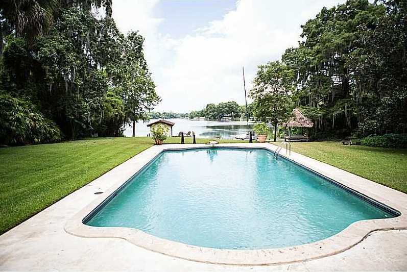Large swimming pool overlooking the lake and private dock.