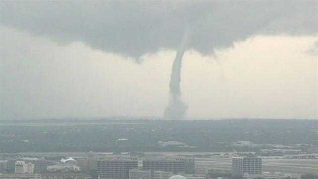A waterspout came ashore in the Tampa Bay area on Monday.