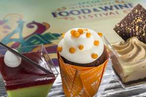 Food and Wine guests can sample three sweet treats in one stop at the Desserts & Champagne Marketplace.  The trio, new this year, includes Cherry Pistachio Mousse, Orange Cupcake and Hazelnut Cheesecake.