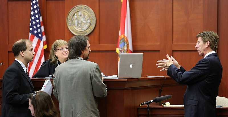 Defense counsel Mark O'Mara (far right) addresses forensics animation expert Daniel Shumaker as he testifies, with Assistant State Attorney Richard Mantei (far left) and Judge Debra Nelson looking on, in the George Zimmerman trial in Seminole circuit court, in Sanford, Fla., Tuesday, July 9, 2013. Zimmerman is charged with 2nd-degree murder in the fatal shooting of Trayvon Martin, an unarmed teen, in 2012. (Joe Burbank/Orlando Sentinel/POOL)